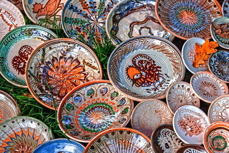 Romanian traditional ceramic in the plates form, painted with specific reasons Horezu area  photo