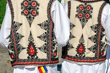Two people with old traditional Romanian folk costume  Specific Banat, Romania Фото со стока - 22980641