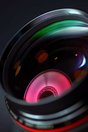 Professional photo lens closeup with colorful reflections
