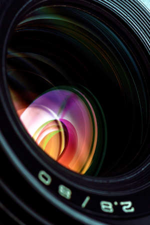 camera lens: Professional photo lens closeup with colorful reflections