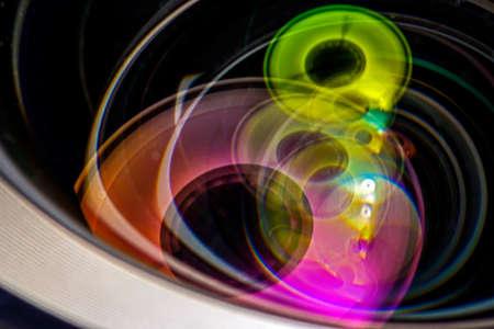 Professional photo lens closeup with colorful reflections  photo