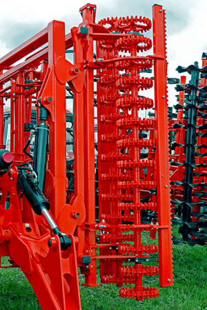 harrowing: Equipment for agriculture, presented to an agricultural exhibition.