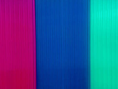 Background with multicolored polycarbonate plates that are used in construction.