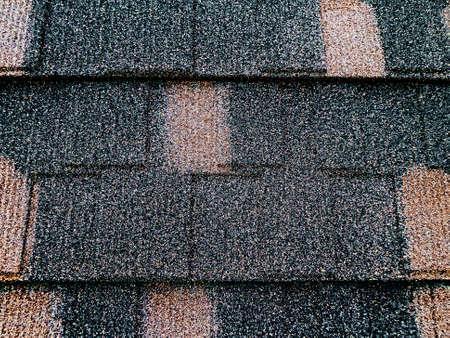 Colored asphalt roof structure that mimics the tiles. photo