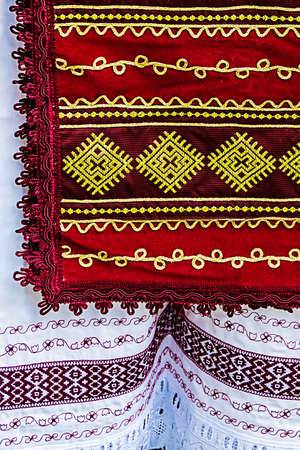 Material with romanian traditional embroidery, used to women clothes. photo