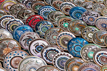 reasons: Romanian traditional ceramic in the plates form, painted with specific reasons Horezu area.