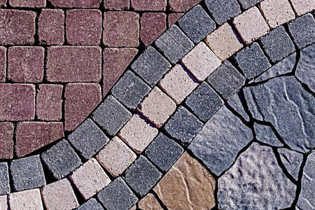 Detail of cobblestone sidewalk made of cubic stones. photo