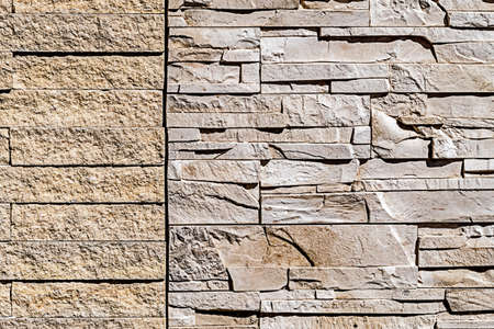 Decorative wall from ornamental stones, on brown and white colors. photo