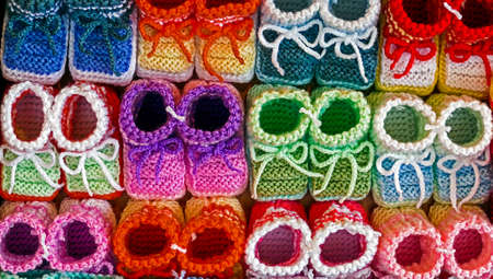 Knitted booties for newborns, from colored wool and exposed to sale. photo