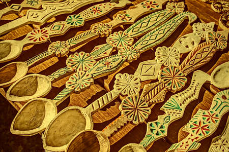 traditionally: Wooden spoons carved and decorated traditionally Romanian. Vintage processed.