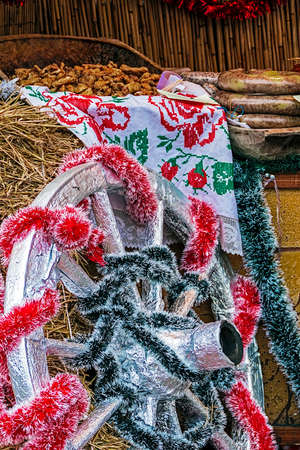 specific: Specific and rustic Christmas decorations at a street fair with traditional romanian food. Stock Photo