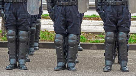 rehearse: Street police forces in alignment with the specific safety equipment. Stock Photo