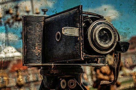 Old photo with old photo camera. Antiques Fair in Timisoara, Romania. Vintage processed. Stock Photo
