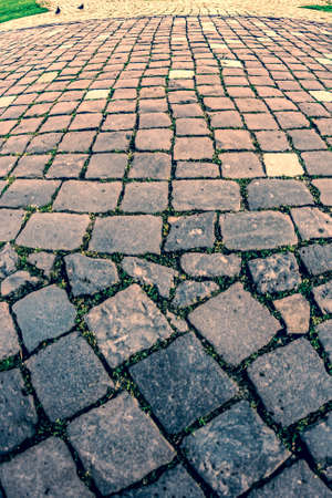 cubic: Vintage look at cobblestone sidewalk made of old cubic stones.