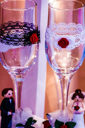 specifically: Glasses decorated specifically for wedding and figurine from gingerbread  symbolizing a bride and one groom.