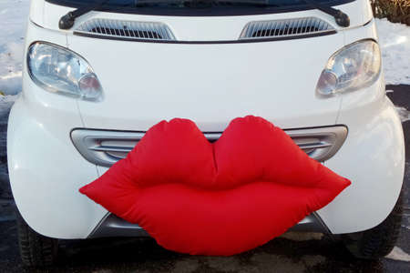 wedlock: Car for just married, decorated with a big mouth red.