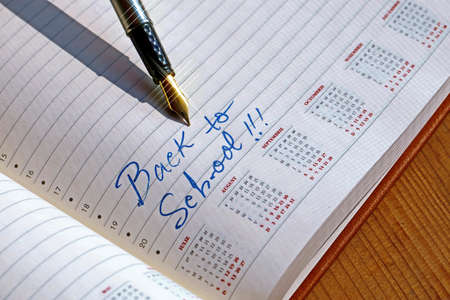 open diary: Open diary with one fountain pen that write BACK TO SCHOOL.