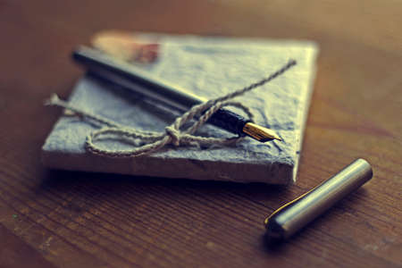 old diary: Old diary memories with fountain pen on a wooden table. Vintage processing. Stock Photo