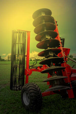 harrowing: Agricultural equipment in sunset light. Image digitally manipulated.