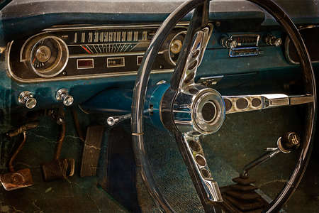 Old postcard with driver's cockpit of a vintage classic car. Vintage processed.