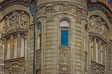 heads old building facade: Architectural details on a historic building in Timisoara Romania. Image digitally manipulated as one old photo.