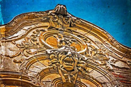 heads old building facade: Architectural details on a historic building in Union Square Timisoara, Romania Stock Photo