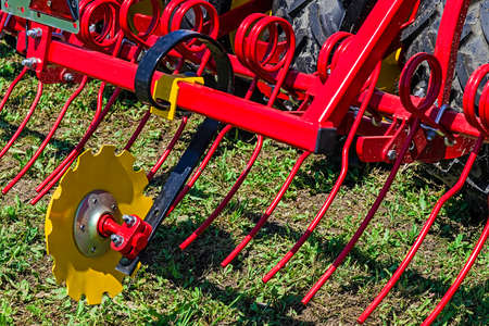 harrowing: Equipment for agriculture presented to an agricultural exhibition.