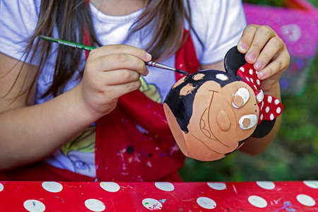 Children painting pottery at a workshop organized by the International Children's Day in Timisoara Romania. 写真素材