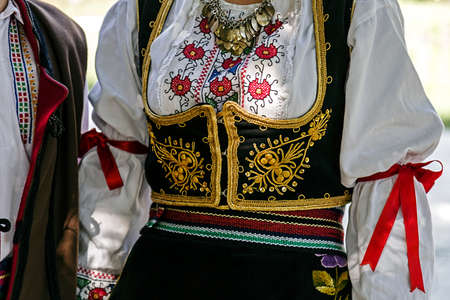 serbian: Old traditional Serbian folk costume for women.Detail.