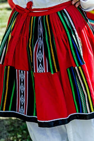 bulgarian ethnicity: Detail of Bulgarian folk women skirt with multicolored embroidery.