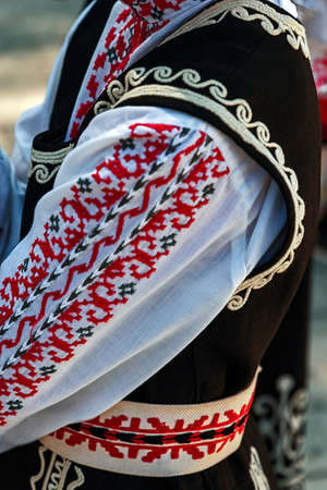 bulgarian ethnicity: Detail of Bulgarian folk costume for women with multicolored embroidery. Stock Photo