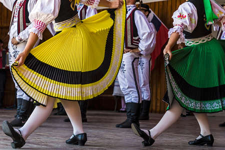 czech: Young Czechs dancers in traditional costume perform folk dance.