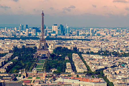 la defense: Vintage aerial view, from Montparnasse tower, with Eiffel tower and La Defense district in Paris, France. Stock Photo