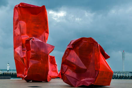 strangers: OSTEND, BELGIUM - OCTOBER 13, 2015: Famous sculpture composition Rock Strangers by Arne Quinze, placed on sea cliff. Stock Photo