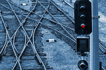 Railway junction in Timisoara, Romania. Railroad tracks in blue background.