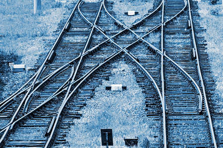 Railway junction in Timisoara, Romania. Railroad tracks in blue background.