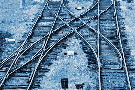 railway: Railway junction in Timisoara, Romania. Railroad tracks in blue background.