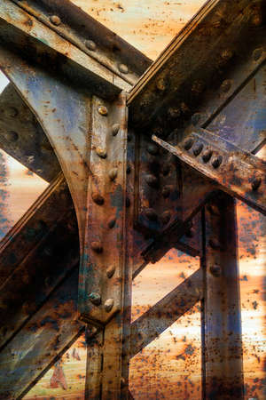 metal structure: Structure of rusty metal beams fastened with rivets. Stock Photo
