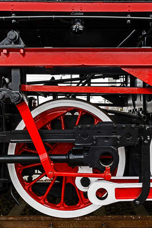 chamber of the engine: Old german steam locomotive in a museum. Detail and close up of huge wheels.