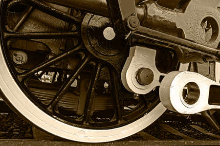 chamber of the engine: Old german steam locomotive in a museum. Detail and close up of huge wheels. Sepia processing.