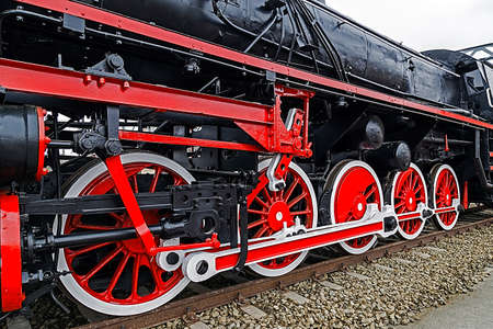 chamber of the engine: Old german steam locomotive, built in 1940, in a museum. The heaviest locomotive, 85 tons, that circulated in Romania during the Second World War. Detail and close up of huge wheels.