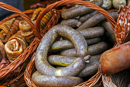 placed: Traditional romanian sausages specialty, placed in a wicker basket. Shall specify for the month of December in Maramures area, Romania. Stock Photo