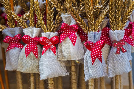 gift bags: Winter decoration made of sticks wheat and bags with red knot, used during the Saint Nicholas day and night in December. Stock Photo