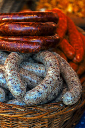 specify: Traditional romanian sausages specialty, placed in a wicker basket. Shall specify for the month of December in Maramures area, Romania. Stock Photo
