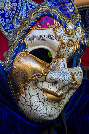 satirical: VENICE, ITALY - JANUARY 23, 2016: Typical colorful mask from the venice carnival, Venice, Italy, 2016.