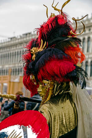 satirical: VENICE, ITALY - JANUARY 24, 2016: An unidentified person in a carnival costume attends at the Carnival of Venice , January 24, 2016 in Venice , Italy. Editorial