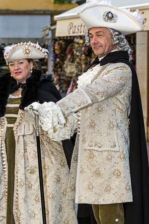 period costume: VENICE, ITALY - JANUARY 23, 2016: People on the street in Venice, dressed in period costumes for the carnival.