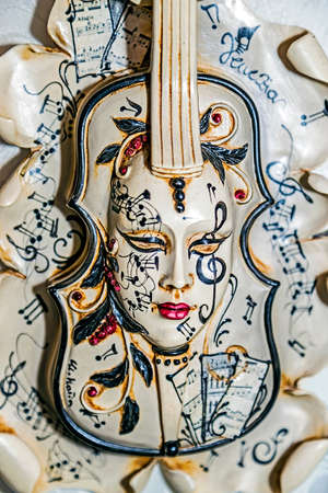 carnival in venice: VENICE, ITALY - JANUARY 23, 2016: Typical colorful mask from the venice carnival, Venice, Italy, 2016.