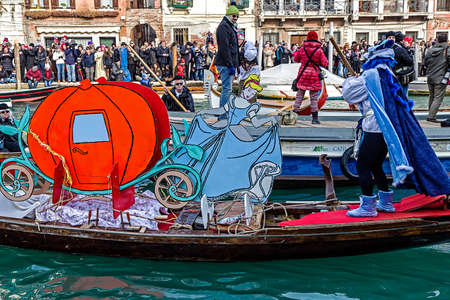 venice: VENICE, ITALY - JANUARY 24, 2016: Carnival procession on the Cannaregio Canal on January 24, 2016 in Venice Italy