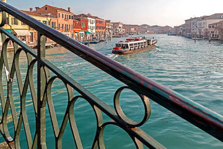 Murano: MURANO, ITALY - JANUARY 25, 2016: Venice, Italy, Murano water boats canal and traditional buildings.117 islands separated by canals and bridges. Murano is glass making island. World Heritage Site.